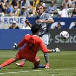 Seattle Sounders forward Jordan Morris, right, scores past Los Angeles Galaxy goalkeeper Brian Rowe during the first half of a MLS soccer match Sunday, April 23, 2017, in Carson, Calif. (AP Photo/Mark J. Terrill)