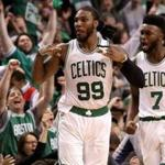 Boston, MA - 4/30/2017 - (4th quarter) Boston Celtics forward Jae Crowder (99) and Boston Celtics forward Jaylen Brown (7) celebrate Crowder's three pointer for a 112-102 lead with 4:45 left in the fourth quarter. The Boston Celtics host the Washington Wizards in Game 1 of the Eastern Conference Semi-Finals at TD Garden. - (Barry Chin/Globe Staff), Section: Sports, Reporter: Adam Himmelsbach, Topic: 01Celtics-Wizards, LOID: 8.3.2343214657.