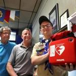 Boy Scout Aaron Christian got a defibrillator for the American Legion post in Abington as part of his Eagle Scout project. He showed the machine alongside post commander Ronald Marston, left, and commander-elect Ken Coburn.