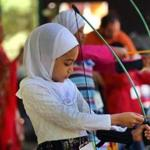 Tawhida Khaifan, 6, loaded an arrow onto her bow during an archery lesson Saturday as part of Islamic Day activities at New England Base Camp, a center for Boy Scouts and Girl Scouts in Milton.