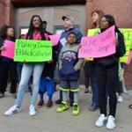 Students protested against the school's policy before its board of trustees met Sunday.