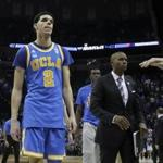 UCLA guard Lonzo Ball (2) leaves the court after UCLA lost to Kentucky in an NCAA college basketball tournament South Regional semifinal game Friday, March 24, 2017, in Memphis, Tenn. (AP Photo/Mark Humphrey)