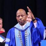 J. Keith Motley acknowledged a standing ovation in his honor at his last commencement as chancellor.