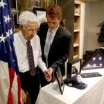 WWII veteran John F. Hurley got a helping hand from US Rep. Joseph P. Kennedy III after Kennedy presented him with medals he earned in Okinawa.
