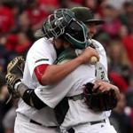 Boston, MA - 5/27/2017 - (9th inning) Boston Red Sox starting pitcher Brian Johnson (61) shares an embrace with Boston Red Sox catcher Sandy Leon (3) following his complete game shutout over the Seattle Mariners. The Boston Red Sox host the Seattle Mariners in the second of a three game series at Fenway Park. - (Barry Chin/Globe Staff), Section: Sports, Reporter: Peter Abraham, Topic: 28Sox-Mariners, LOID: 8.3.2575145591.