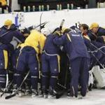 Nashville Predators players and coaches gather together at the end of a practice at their NHL hockey facility Thursday, May 25, 2017, in Nashville, Tenn. (AP Photo/