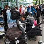 Passengers lined up with their luggage outside Heathrow Airport Terminal 5 on Sunday in London as thousands of travelers faced a second day of disruption after a computer failure caused the airline to cancel most of its services.