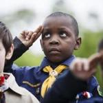 Boston, MA - 5/29/2017 - Cub Scout Miles Gittens, 8, salutes during a Memorial Day parade in Boston, MA, May 29, 2017.(Keith Bedford/Globe Staff)