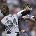 Washington Nationals' Bryce Harper (34) hits San Francisco Giants' Hunter Strickland in the face after being hit with a pitch in the eighth inning of a baseball game Monday, May 29, 2017, in San Francisco. (AP Photo/Ben Margot)