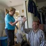 Martha A. Shea, program coordinator of ClearPath, helped Don Gage sort through his cluttered home.