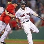 Boston, MA: June 12, 2017: The Red Sox Dustin Pedroia (right) is mobbed by teammates, including Robbie Ross (in red) after his game winning hit in the bottom of the 11th inning. The Boston Red Sox hosted the Philadelphia Phillies in a regular season MLB inter league baseball game at Fenway Park. Globe Staff Photo/ Jim Davis)