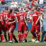 Chicago Fire players gather before an MLS soccer match against Atlanta United, Saturday, June 10, 2017, in Bridgeview, Ill. (AP Photo/Kamil Krzaczynski)