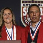 Tony DiCicco (right), with Brandi Chastain, a member of the 1999 World Cup winners, in March.