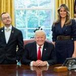 Nikos Giannopoulos (left) posed with President Donald Trump and Melania Trump in the Oval Office.
