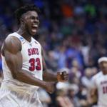 Southern Methodist forward Semi Ojeleye (33) celebrates during a first-round game against Southern California in the men's NCAA college basketball tournament in Tulsa, Okla., Friday, March 17, 2017. Southern California won 66-65. (AP Photo/Sue Ogrocki)