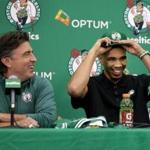 06/23/2017 Waltham Ma- CEO of the Boston Celtics Wyc Grousbeck (cq) left looks on as the Celtics newest player Jayson Tatum (cq) right tries on a hat at a afternoon press-conference. Jonathan Wiggs\Globe Staff Reporter:Topic