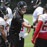 Atlanta Falcons quarterback Matt Ryan greets running backs Devonta Freeman, left, and Tevin Coleman during NFL football practice Tuesday, June 13, 2017, in Flowery Branch, Ga. (Curtis Compton/Atlanta Journal-Constitution via AP)