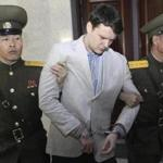 Otto Warmbier (center) was escorted during a March 2016 court hearing in Pyongyang, North Korea.