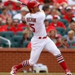 ST. LOUIS, MO - JUNE 26: Randal Grichuk #15 of the St. Louis Cardinals follows through on a two-run home run during the fourth inning against the Cincinnati Reds at Busch Stadium on June 26, 2017 in St. Louis, Missouri. (Photo by Scott Kane/Getty Images)