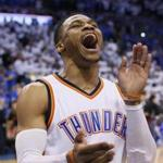 Oklahoma City Thunder guard Russell Westbrook shouts to fans before a first-round NBA basketball playoff game against the Houston Rockets in Oklahoma City, Friday, April 21, 2017. (AP Photo/Sue Ogrocki)