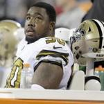 FILE - In this Nov. 17, 2016, file photo, New Orleans Saints' Nick Fairley (90) watches from the bench during the first half of an NFL football game against the Carolina Panthers in Charlotte, N.C. Saints general manager Mickey Loomis says Fairley has been placed on the team's non-football illness list, meaning the starting defensive tackle won't play this season. This offseason he's been visiting heart specialists because of symptoms related to an enlarged heart. (AP Photo/Bob Leverone, File)