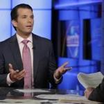 FILE - In this July 11, 2017 file photo, Donald Trump Jr., left, speaks in New York. A lawyer for a Russian developer says a company representative was the eighth person at a Trump Tower meeting brokered by Donald Trump Jr. during the campaign. (AP Photo/Richard Drew, File)