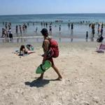 Lifeguard James Kelly patrolled the beach at Hampton Beach Friday.