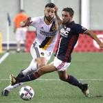 Foxborough MA 07/22/17 New England Revolution Digeo Fagundez controls the ball in front of Los Angeles Galaxy Romain Allessandrini during first half MLS action at Gillette Stadium. (Matthew J. Lee/Globe staff) topic: reporter: