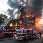 Fire officials were still searching Monday for the cause of an 8-alarm blaze in Waltham Sunday.