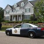 Police officers were outside the home of Aaron Hernandez in North Attleboro in 2013 after the former Patriots tight end's arrest. A deal to sell the home recently fell through, a lawyer for Hernandez's estate said.