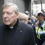 Cardinal George Pell left court under a heavy police guard Wednesday in Melbourne.
