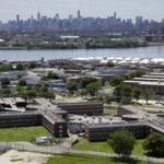 The Rikers Island jail complex stands in New York with the Manhattan skyline in the background in a June 2014 file photo.