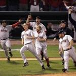 10-27-2004:St. Louis,MO:GLOBE STAFF PHOTO/STAN GROSSFELD- Red Sox players storm the field after winning the World Championship. Library Tag 10292004 Sports- 2004 World Champions Boston Red Sox