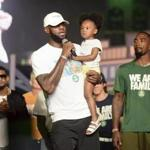 LeBron James held his daughter, Zhuri, during an event Tuesday in Sandusky, Ohio on Tuesday.