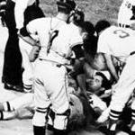 Boston, MA - 8/18/1967: Boston Red Sox player Tony Conigliaro is surrounded by teammates after being hit on the head by a fourth-inning fast ball from Jack Hamilton of the California Angels, during at game at Fenway Park in Boston on August 18, 1967. Conigliaro suffered a fractured cheekbone and scalp contusion. (Charles B. Carey/Globe Staff) --- BGPA Reference: 140404_CB_019