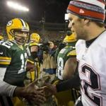Green Bay, WI 11/30/14 Green Bay Packers quarterback Aaron Rodgers shaking hands with New England Patriots quarterback Tom Brady after they defeated the Patriots 26-21 at Lambeau Field on Sunday November 30, 2014. (Matthew J. Lee/Globe staff) Topic: Patriots Reporter:
