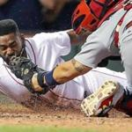 Boston, MA: August 16, 2017: The Red Sox Jackie Bradley, Jr. dives head first and beats the tag of Cardinals catcher Yadier Molina, who couldn't hold on to the ball as he scores the game winning run in the bottom of the ninth inning on a hit by teammate Mookie Betts. The Boston Red Sox hosted the St. Louis Cardinals in a regular season inter league MLB baseball game at Fenway Park. (Jim Davis/Globe Staff).