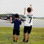 for 20namesChopper - Cody McKinstry, 10, of East Thetford, Vt., and his brother Kaleb, 5, watch a helicopter with the Trump name written on the side take off from the Lebanon Municipal Airport in West Lebanon, N.H., on Aug. 14, 2017. It was Cody's birthday and they were having lunch with their mother in their car near the airport control tower when they saw the helicopter land, refuel and take off in a half-hour. Cody asked the flight crew if the aircraft belonged to the President and they said yes. (Valley News - Geoff Hansen) Copyright Valley News. May not be reprinted or used online without permission. Send requests to permission@vnews.com.