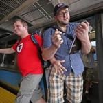 Alex Cox (left) and Dominic DiLuzio, stopwatch in hand, arrived at Wonderland Station as they tried to set a record for visiting every T station on every subway line the fastest.