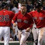 8Boston, MA - 8/18/2017 - (8th inning) Boston Red Sox catcher Christian Vazquez (7) and Boston Red Sox third baseman Rafael Devers (11) added on two more runs in the eighth inning on a Jackie Bradley single. The Boston Red Sox host the New York Yankees in the first of a three game series at Fenway Park. - (Barry Chin/Globe Staff), Section: Sports, Reporter: Peter Abraham, Topic: 19Red Sox-Yankees, LOID: 8.3.3445217437.