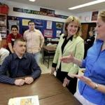 Beth Lindstrom spoke (center) to students at Stoneham High School in 2005.