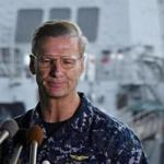 Vice Admiral Joseph Aucoin, Commander of the US 7th Fleet, looks on during a press conference as the damaged US Navy destroyer USS Fitzgerald is seen in the background at Yokosuka Naval Base in Yokosuka, south of Tokyo, in June.