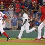 Boston, MA: August 31, 2017: The Red Sox Hanley Ramirez is doused by teammates as they chase him following his bottom of the 19th inning game winning single that drove in Mookie Betts (50, at left) that gave Boston a 3-2 victory. The Boston Red Sox hosted the Toronto Blue Jays in a regular season MLB baseball game at Fenway Park. (Jim Davis/Globe Staff).