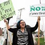 Milford, MA -- 09/16/17 -- Frankie Pinedo protests against a proposed ban on licensed cannabis companies in the town of Milford, on September 16, 2017, in Milford, Massachusetts. Milford Citizens for Fairness held a rally to remind residents to vote against the ban this Tuesday. (Kayana Szymczak for The Boston Globe)