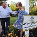 Norwell-09/13/17- Nicole Schindler, 13 of Norwell has a sixty percent chance of surviving after she was diagnosed with pediatric cancer over two and a half years ago. She underwent extreme radiation therapy at Mass General Hospital for the tumor in her head. Her father Gerald helps her after she placed a sign by Wicked Good Cause in their front yard to help raise awareness to pediatric cancer. John Tlumacki/Globe Staff(south)