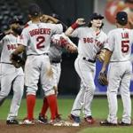Boston Red Sox's Andrew Benintendi, second from right, celebrates with teammates after closing out a baseball game against the Baltimore Orioles in Baltimore, Monday, Sept. 18, 2017. (AP Photo/Patrick Semansky)