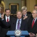 Sen. Lindsey Graham, R-S.C., joined by, from left, Sen. Roy Blunt, R-Mo., Majority Whip John Cornyn, R-Texas, Sen. John Barrasso, R-Wyo., Sen. Bill Cassidy, R-La., Senate Majority Leader Mitch McConnell, R-Ky., and Sen. John Thune, R-S.D., speaks to reporters as he pushes a last-ditch effort to uproot former President Barack Obama's health care law, at the Capitol in Washington, Tuesday, Sept. 19, 2017. To win, 50 of the 52 GOP senators must back it _ a margin they failed to reach when the chamber rejected the effort in July. (AP Photo/J. Scott Applewhite)