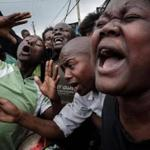 (FILES) This file photo taken on September 1, 2017 shows supporters of Kenya's opposition National Super Alliance (NASA) joking as they pretend to cry for Kenyan President Uhuru Kenyatta on a street of Kibera slum in Nairobi. Doubts are growing over Kenya's ability to hold a rerun of its presidential election in just one month as key players remain unable to agree on how to conduct a credible vote, analysts say. Bickering on all sides and confusion over the process have only increased as the clock ticks down to the October 17 vote, called after the Supreme Court annulled the initial August election, citing widespread irregularities. / AFP PHOTO / YASUYOSHI CHIBAYASUYOSHI CHIBA/AFP/Getty Images