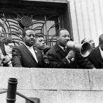 Martin Luther King, Jr. addressed a crowd at the Patrick Campbell School in Roxbury in 1965.