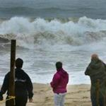 People watched the powerful surf hit Nauset Beach as high tide approached.
